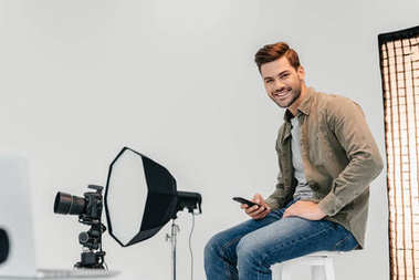 Professional photographer in photo studio