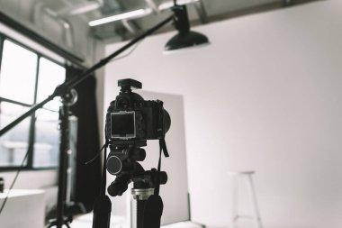 Digital photo camera in photo studio with lighting equipment stock vector