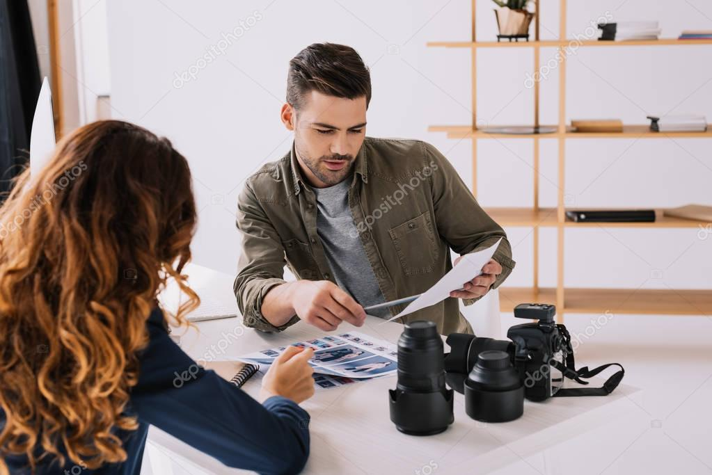 photographer and model choosing photos
