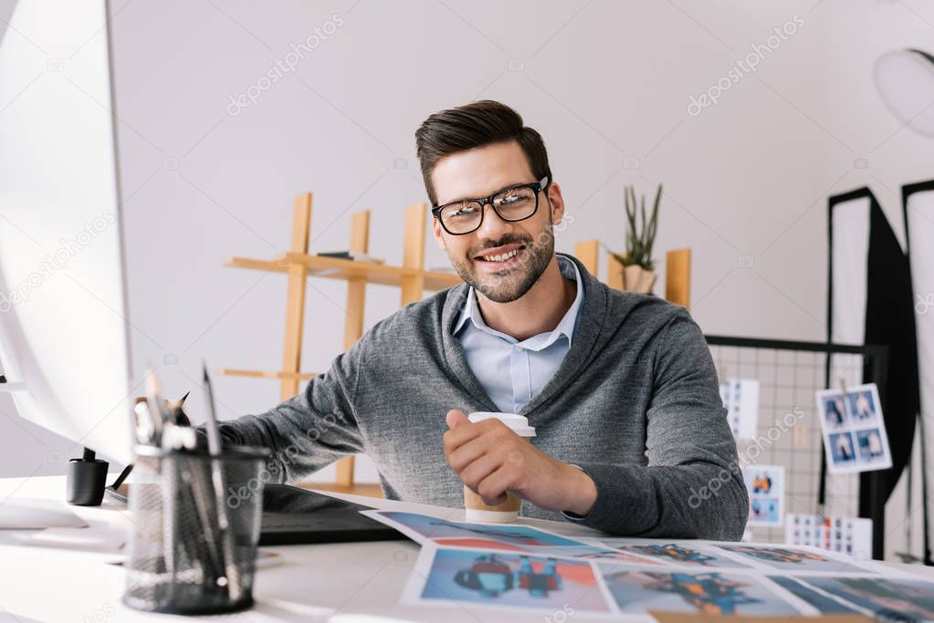 photographer with graphics tablet and photos