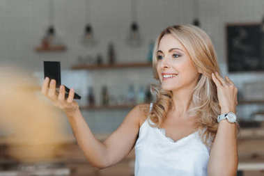 Woman looking at cosmetic mirror