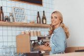 barista with coffee machine