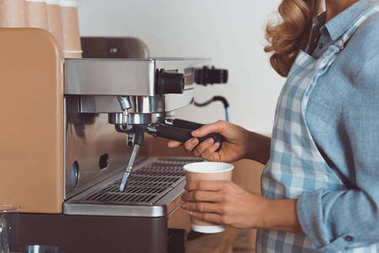 barista with coffee machine