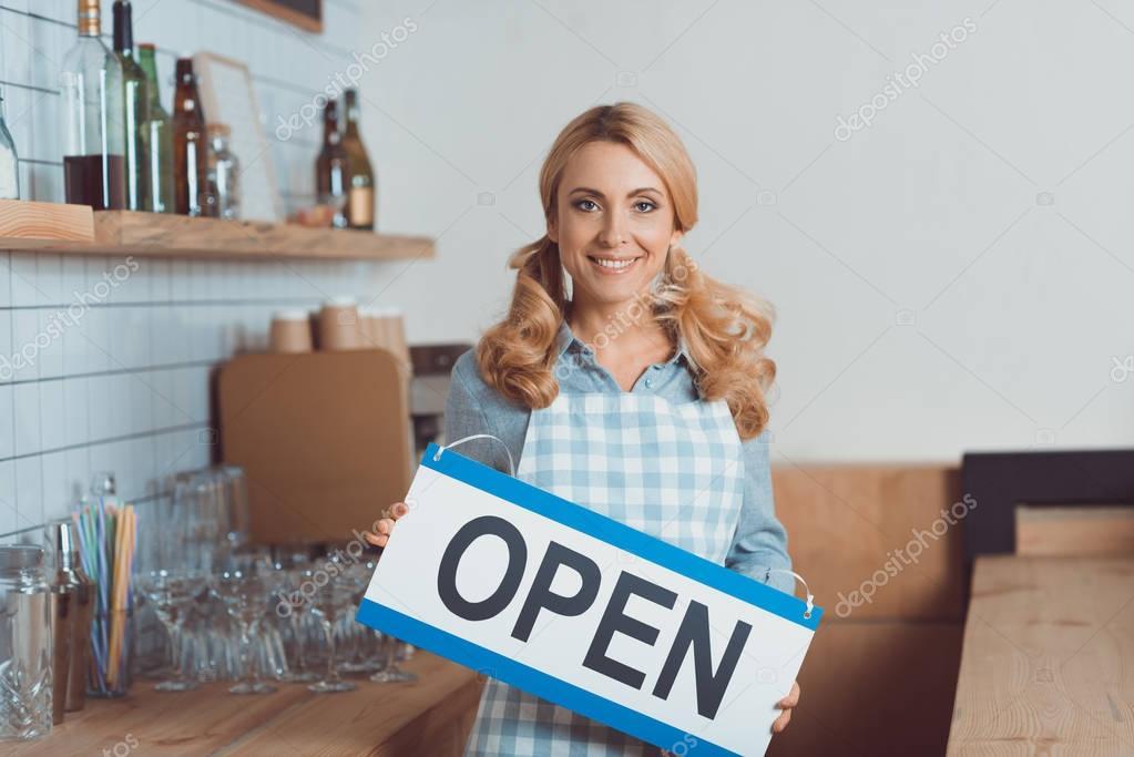 waitress holding sign open