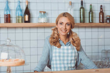 beautiful cafe owner in apron