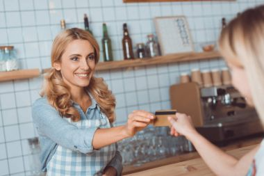 payment with credit card in cafe