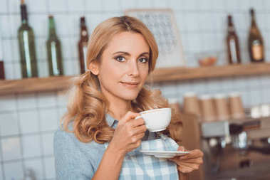 cafe owner drinking coffee