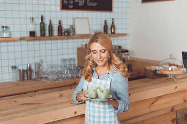 waitress holding plate with dessert