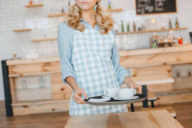 waitress with utensils and tray