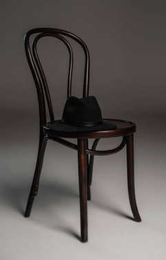 Wooden chair and hat
