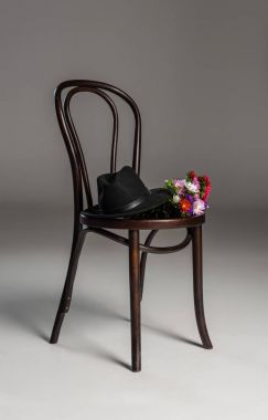 Wooden chair with hat and flowers