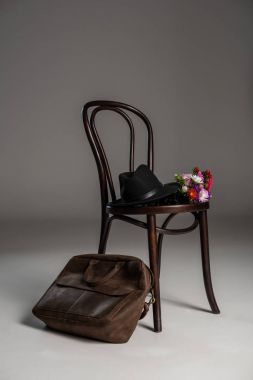 Wooden chair and leather bag
