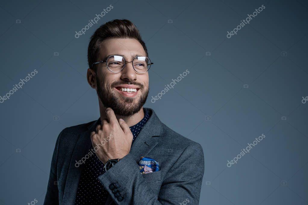 man in suit scratching beard