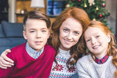 Fotografie mother and kids embracing on christmas