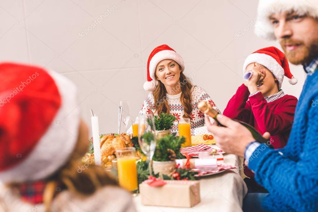 family having fun on christmas dinner