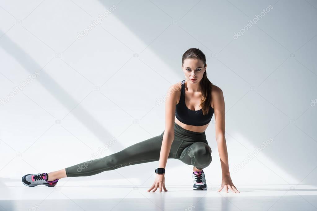 sportswoman stretching legs