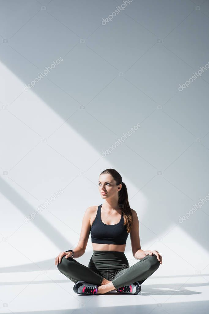 sportswoman sitting with crossed legs