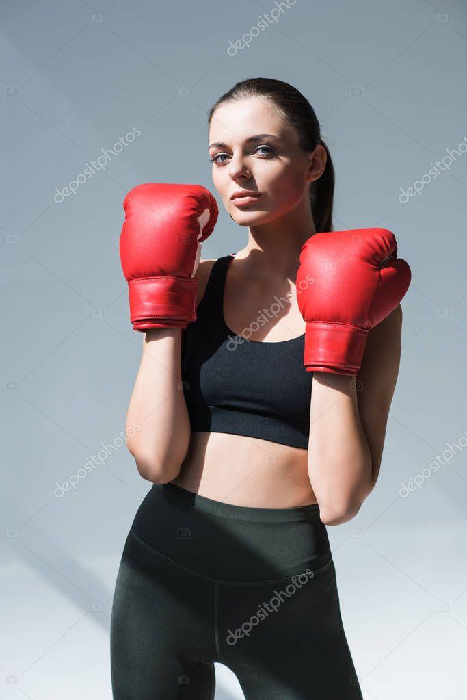 sporty girl in boxing gloves