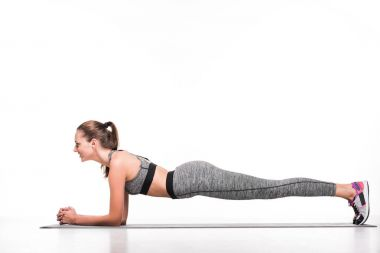 sportswoman exercising on yoga mat