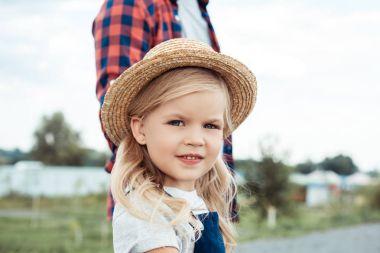 Kid in straw hat