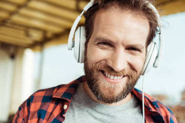 Smiling man in headphones