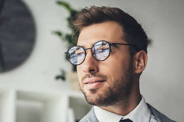 businessman in stylish suit and eyeglasses