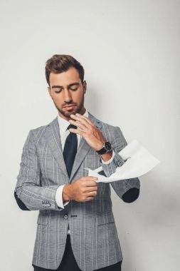Businessman rupture paper with hand