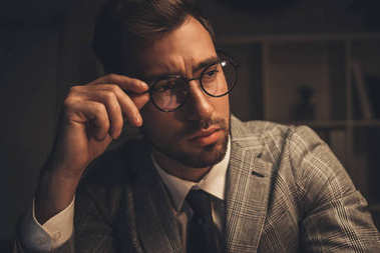 stylish businessman in eyeglasses