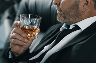 businessman with glass of whiskey