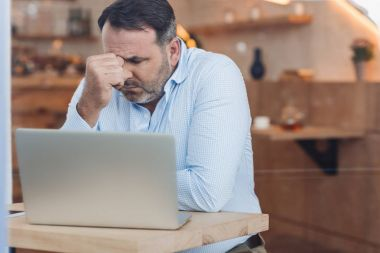 depressed businessman with laptop