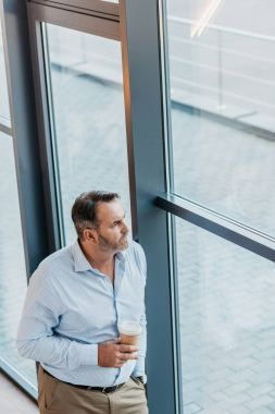 Mature businessman with coffee