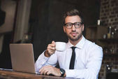 businessman at cafe with laptop