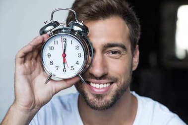 man with alarm clock