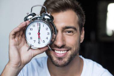 man with alarm clock