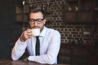 businessman drinking coffee at cafe