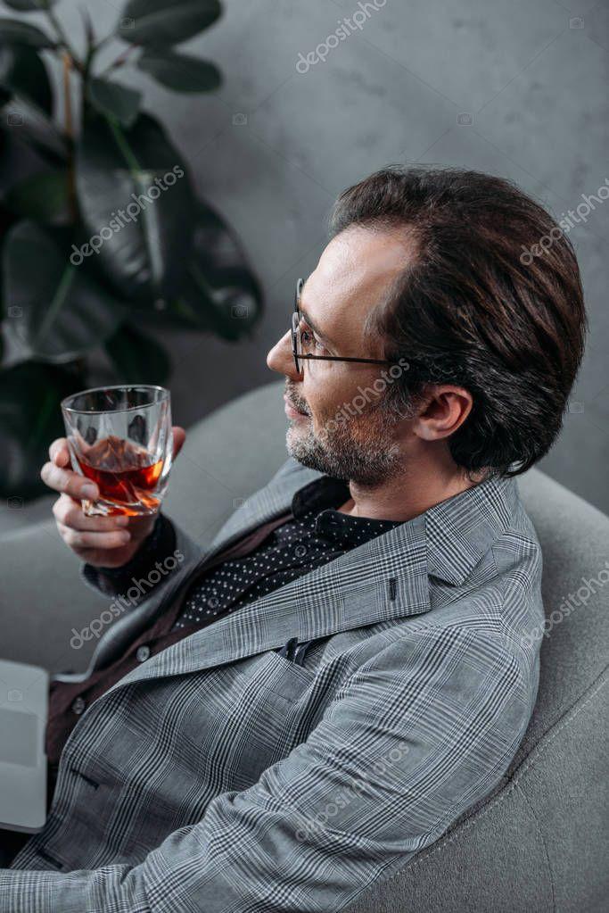businessman drinking whiskey