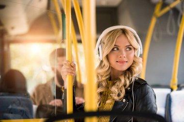 girl listening music in bus