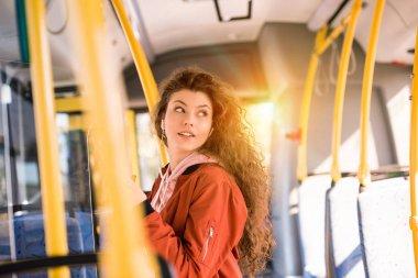 smiling girl in city bus