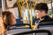 smiling couple in bus