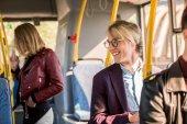 young man in eyeglasses in bus