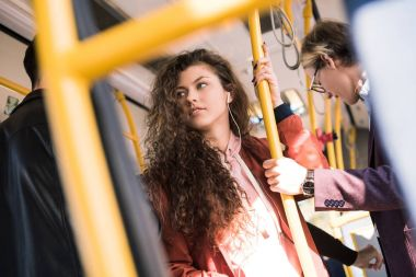 beautiful young woman in bus