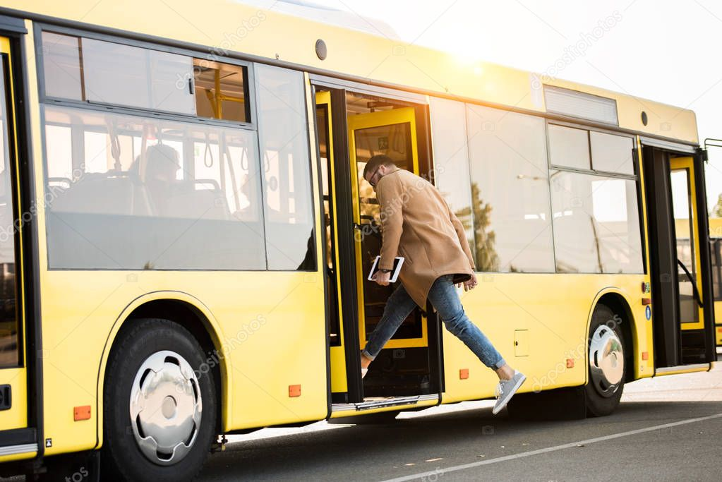 young man entering bus