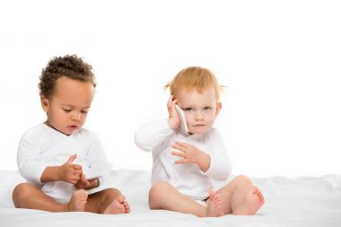 multicultural toddlers with digital smartphones