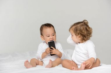 multicultural toddlers with digital smartphone