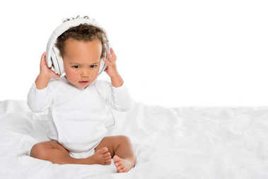 african american toddler with headphones