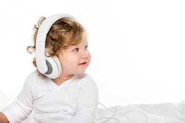 smiling toddler in headphones