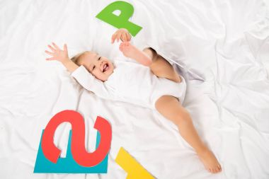 happy baby with paper letters