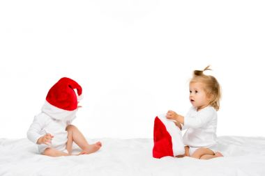 toddlers in santa hats