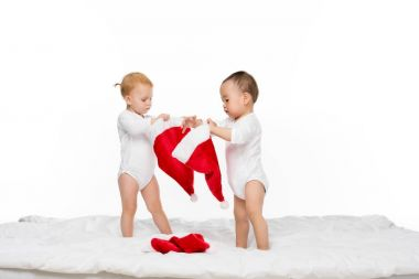 toddlers with santa hats