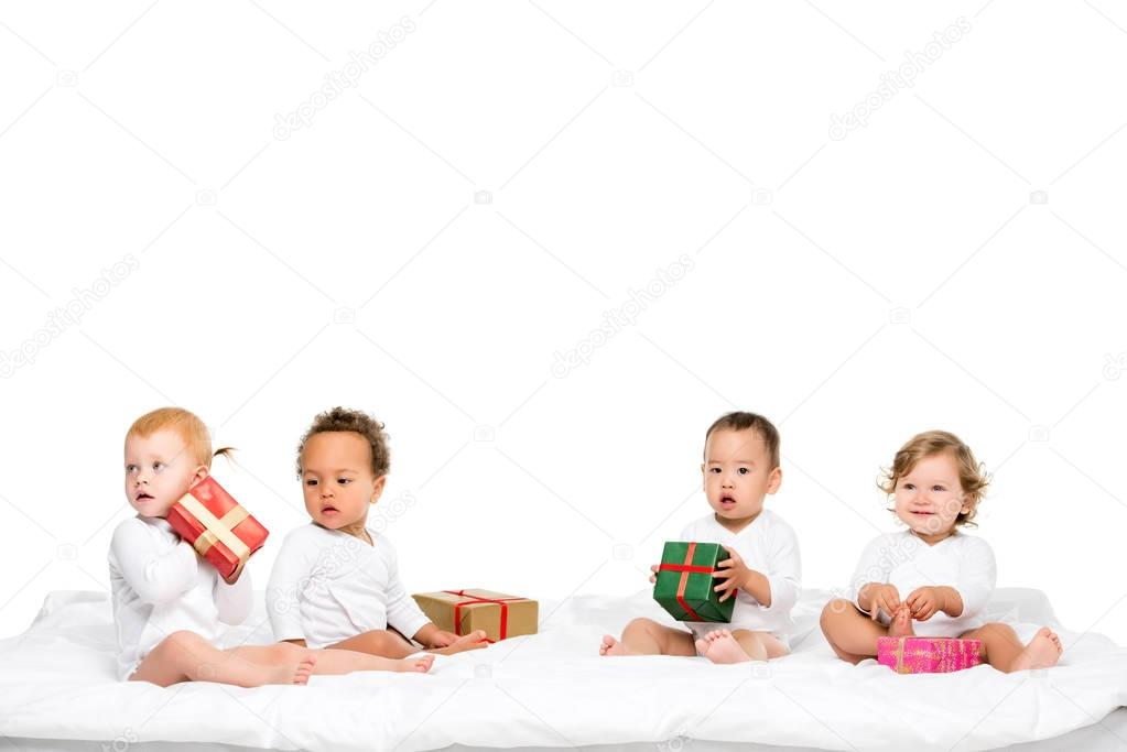 multiethnic toddlers with wrapped gifts